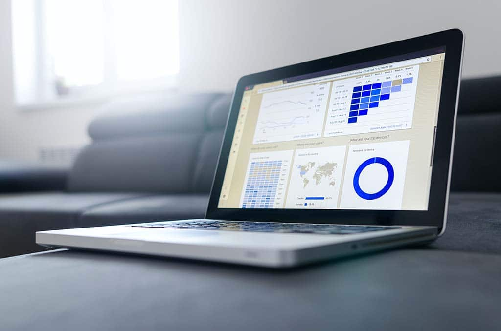 Closeup of a laptop on a couch displaying analytics